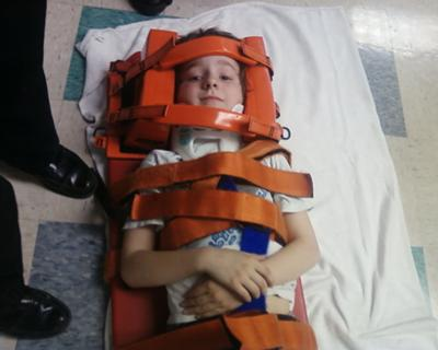 Joey Strapped to a Backboard